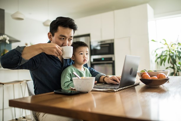 Man balancing childcare and working from home
