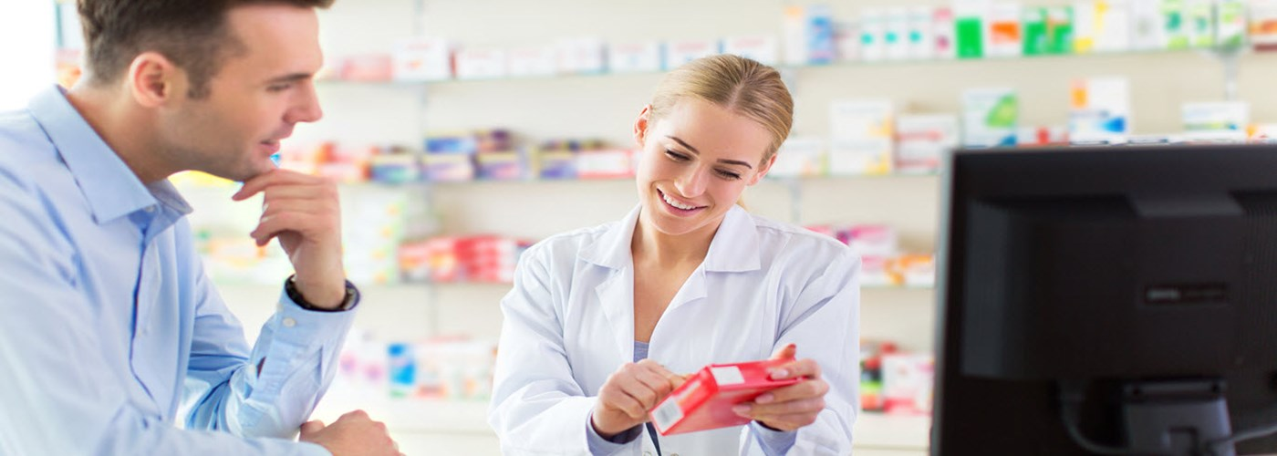 Pharmacist advising patient