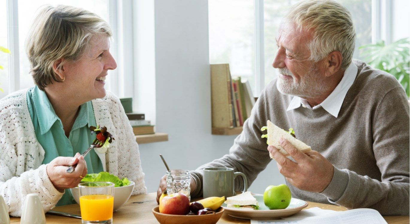 older couple eating healthy food
