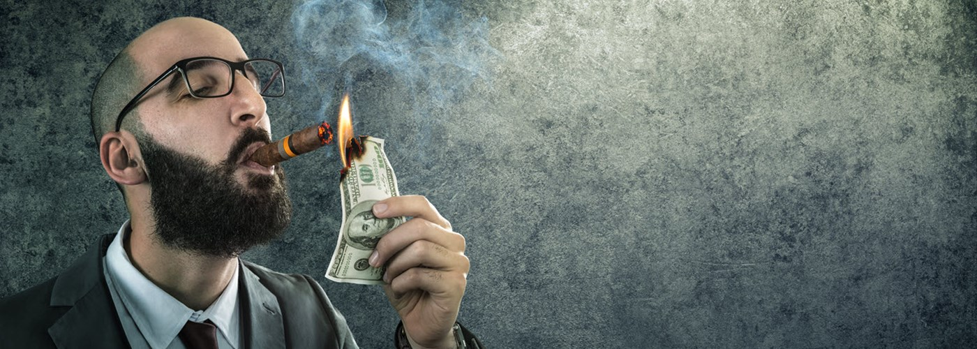 businessman-smoking-burning-money