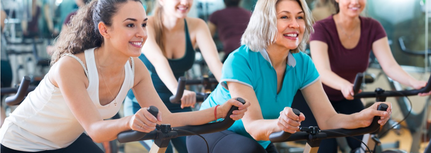 Women of different ages, exercising in spin class