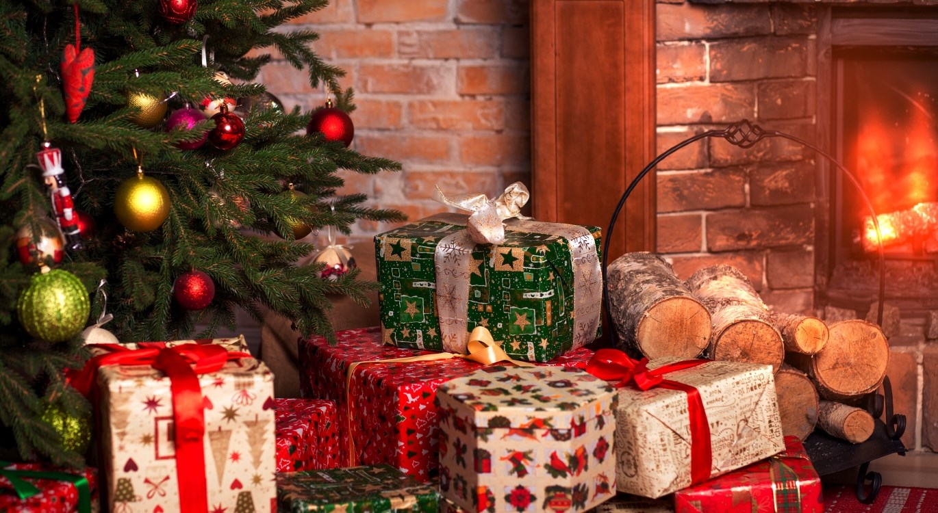 Image of Christmas presents next to fire