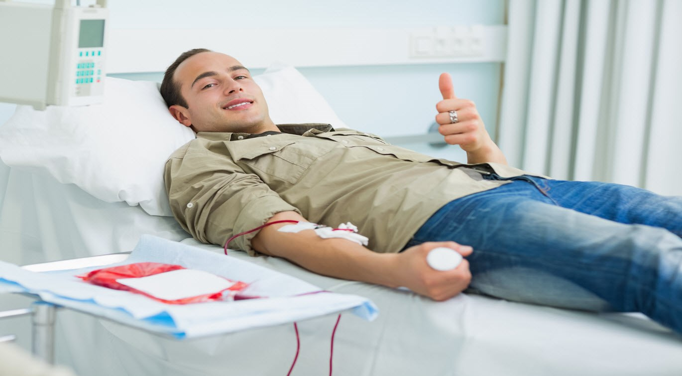 young man giving blood