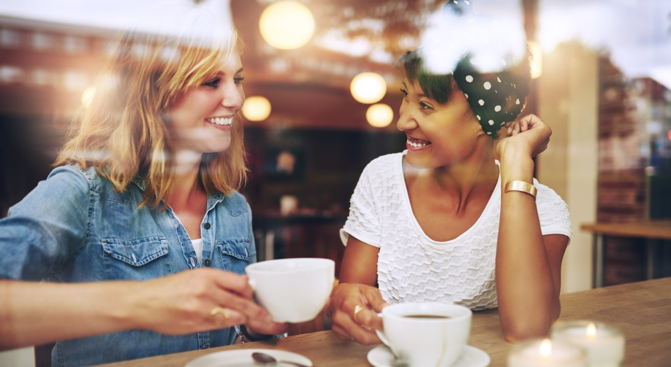 female friends drinking fresh coffee