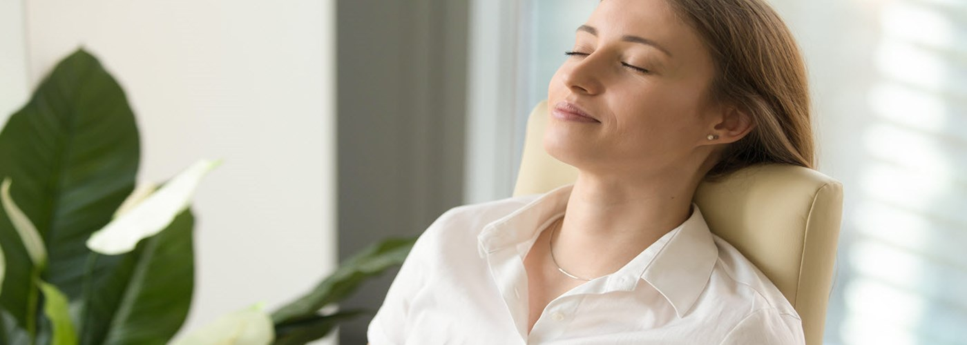 woman relaxing in office