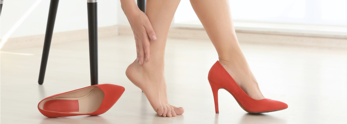 Woman with sore feet after wearing heels at work