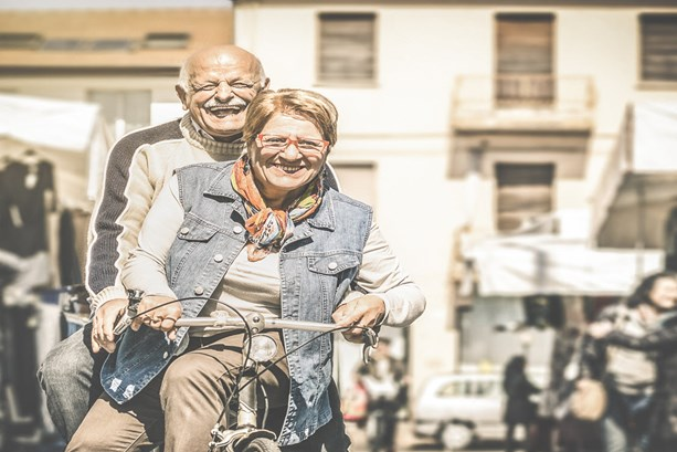 Happy senior couple on bicycle