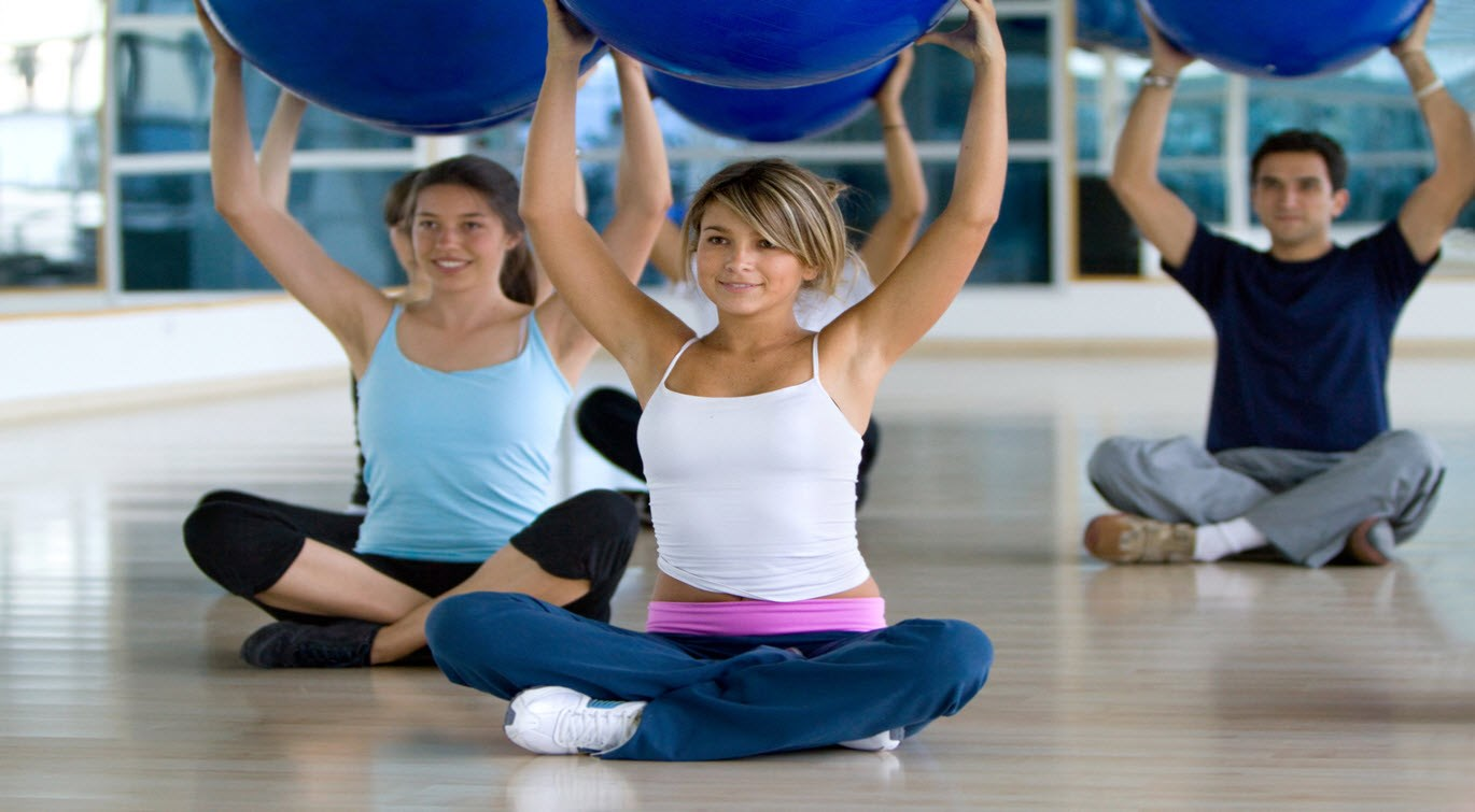 young people in gym - pilates class