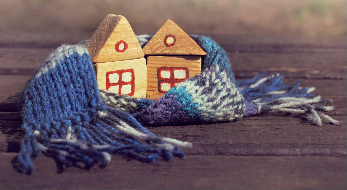 Image of house wrapped-up warm in a scarf