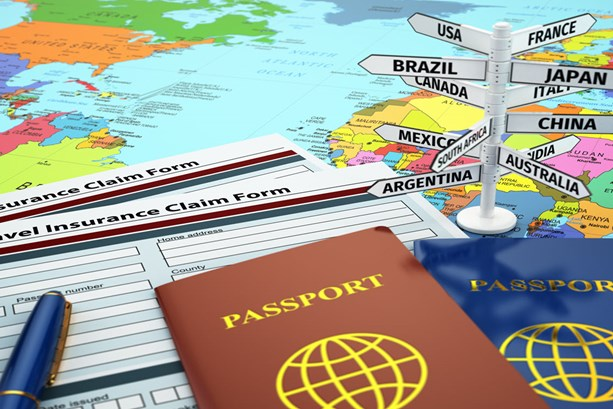 travel-insurance-application-form-passport-and-sign-of-destination-on-the-map