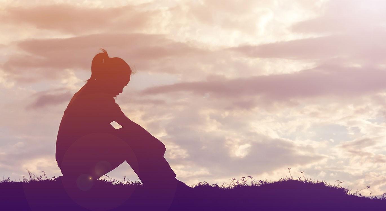 Mental health - Sad depressed woman sitting alone