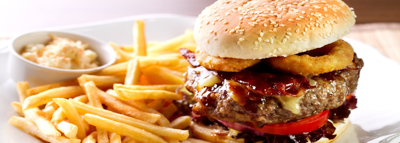 hamburger-sandwich-with-french-fries-and-sauce-on-side