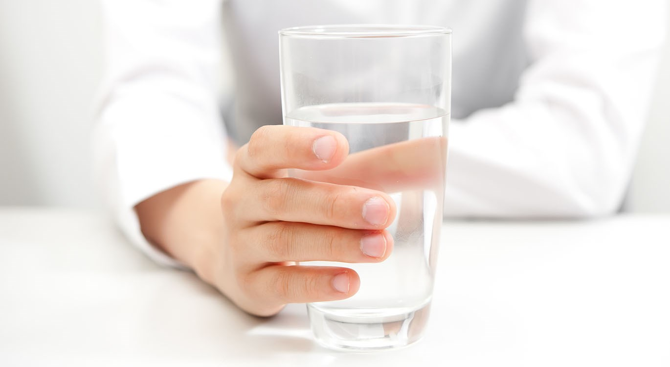 office employee holding a glass of water