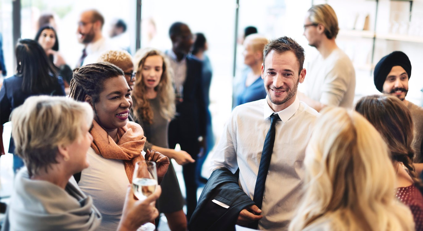 Group of people chatting at a networking event