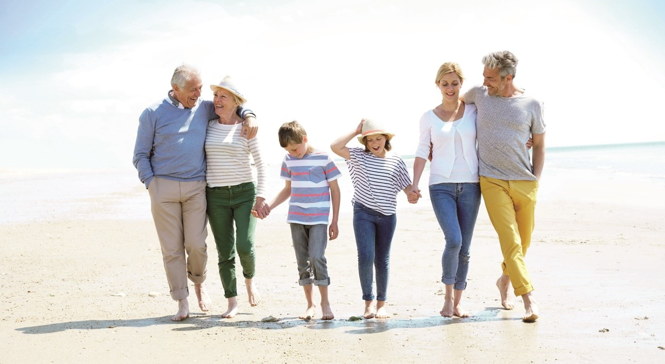 Image of extended family walking on the beach
