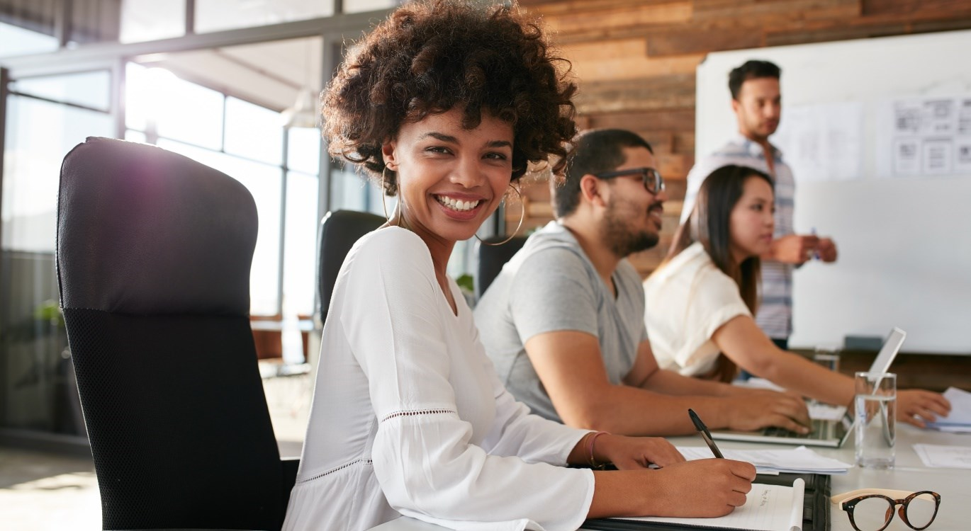 smiling woman in business meeting