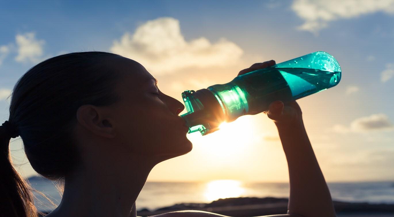 woman-drinking-a-bottle-of-water