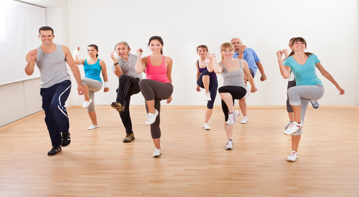diverse-group-of-people-exercising-in-gym