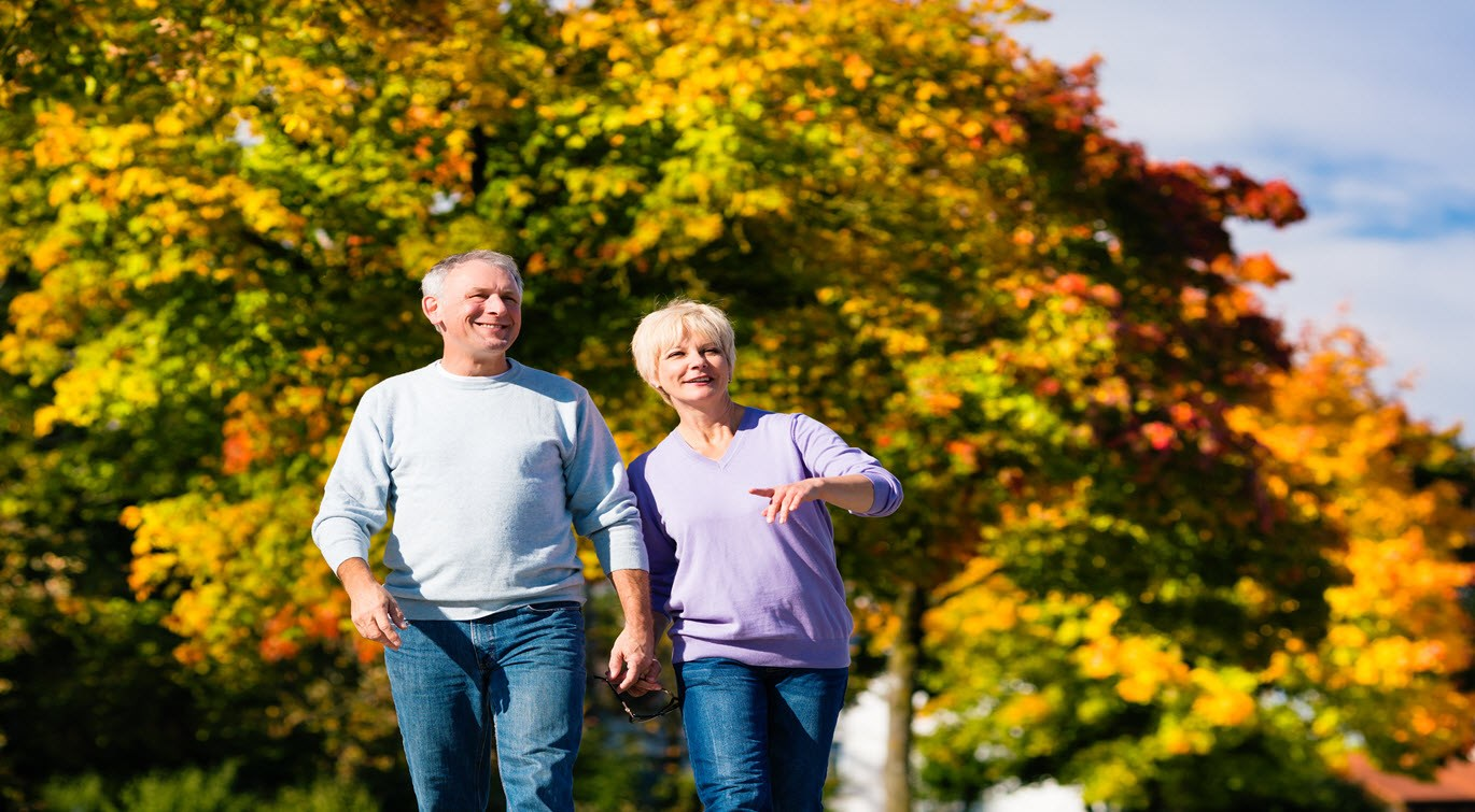 man-and-woman-having-a-walk-in-autumn-outdoors