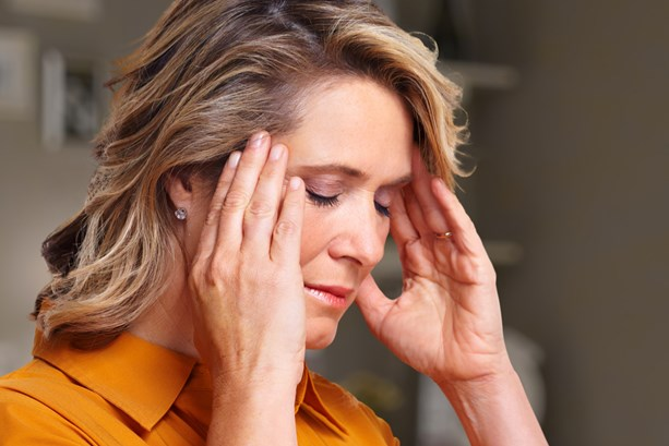 Woman struggling with migraine symptoms