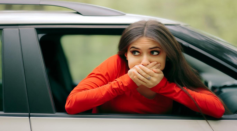 Woman in car. Nauseous