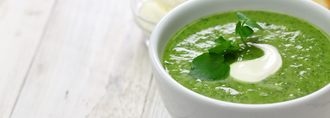Nourishing super green soup in a bowl