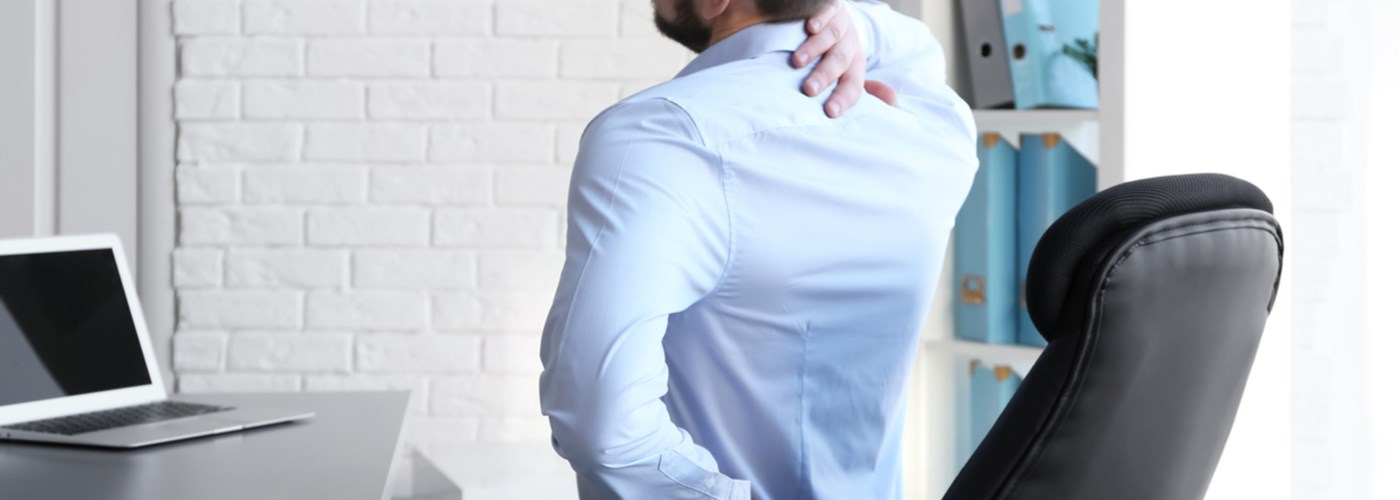 Businessman with a bad back due to poor posture