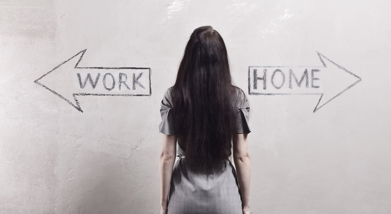 Woman looking at arrows pointing towards work or home