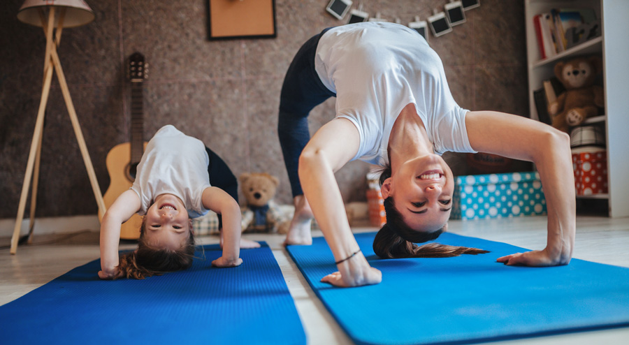 mother and young daughter doing pilates