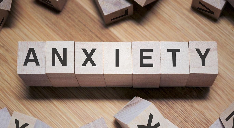 Anxiety word written wooden cubes