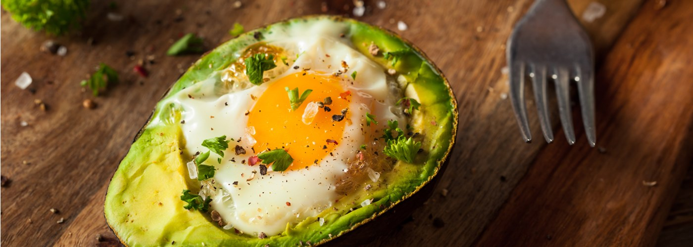 A delicious baked egg inside an avocado