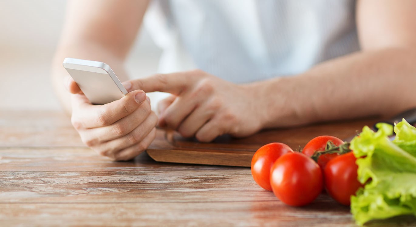 person looking at healthy eating apps on their phone